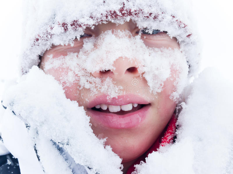 Portrait of a child covered with snow royalty free stock photography