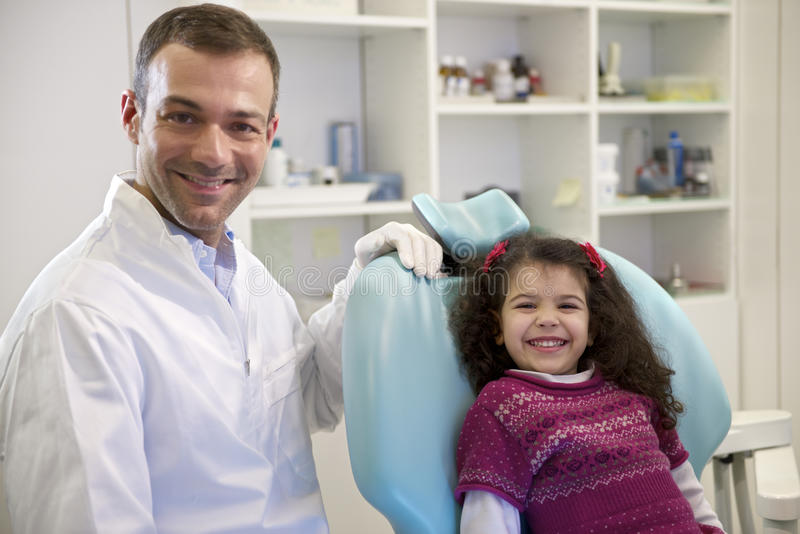 Download Portrait Of Child And Dentist In Dental Studio, Looking At Camer Stock Image - Image: 30700599