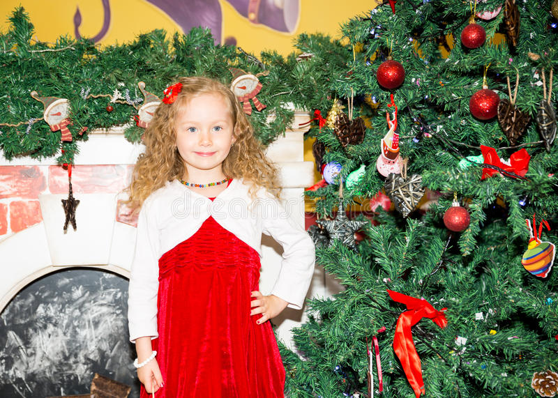 Portrait of child girl around a Christmas tree decorated. Kid on holiday new year. Portrait of child girl around a Christmas tree decorated. Kid on a holiday new royalty free stock photo