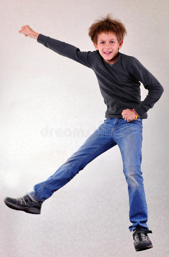 Portrait of child jumping and dancing stock photography
