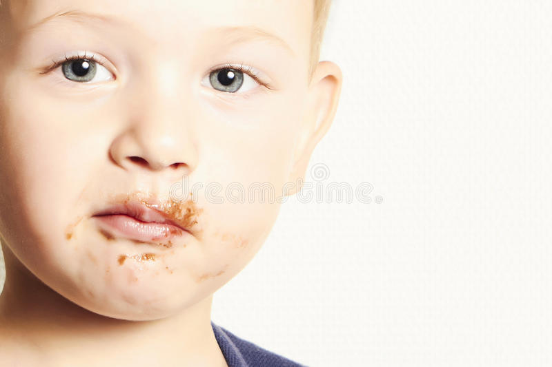 Portrait of child. kid boy with chocolate dirty face stock image