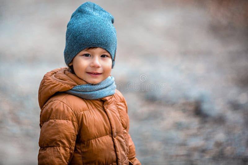 Portrait of a child outdoors. Happy little boy stock photo