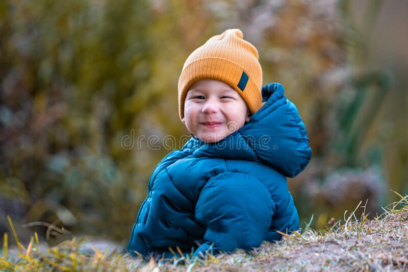 Portrait of a child outdoors. Happy little boy stock photography