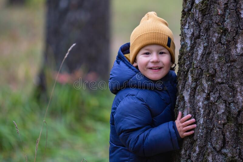 Portrait of a child outdoors. Happy little boy stock image