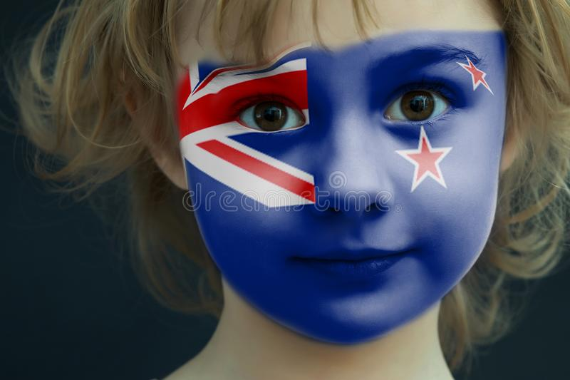 Child with a painted flag of New Zealand stock photos