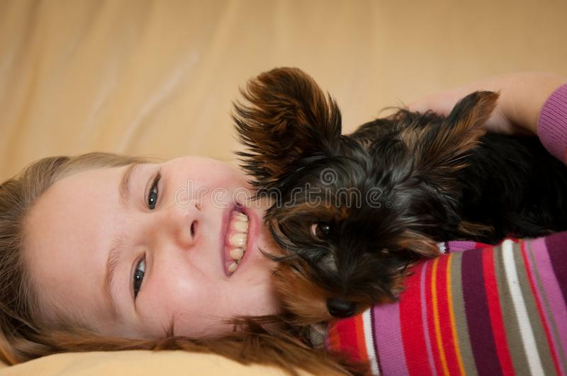 Portrait Of Child Playing With Dog Royalty Free Stock Photos