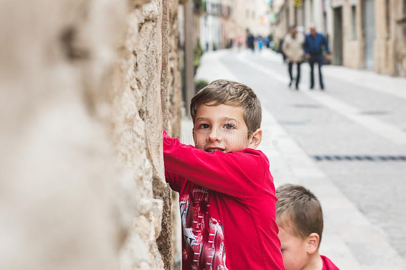 Portrait of a child in the street stock photography