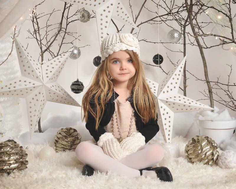 Portrait Of Child In White Winter Background Stock Photo