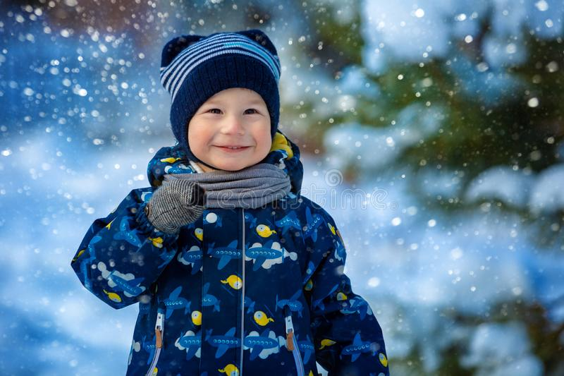 Portrait of a child in the winter in the open air stock image