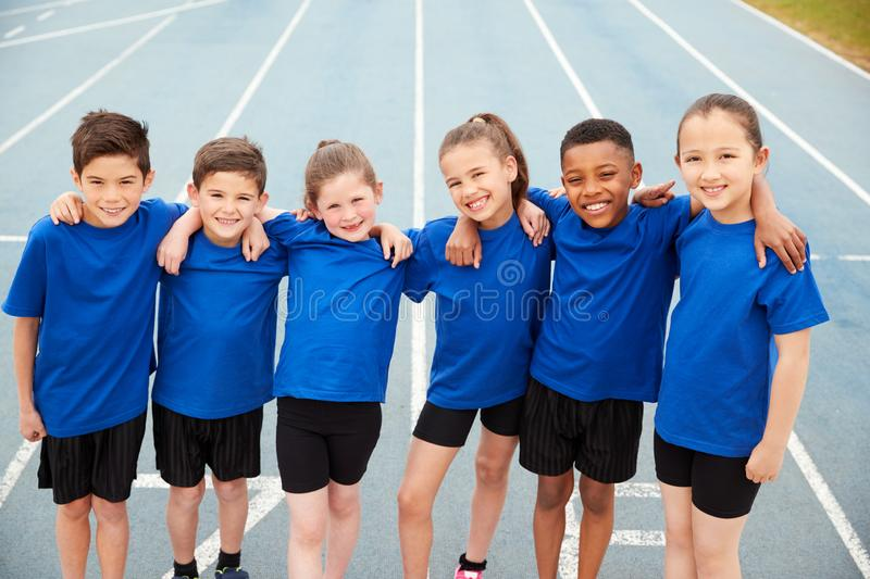 Portrait Of Children In Athletics Team On Track On Sports Day stock images