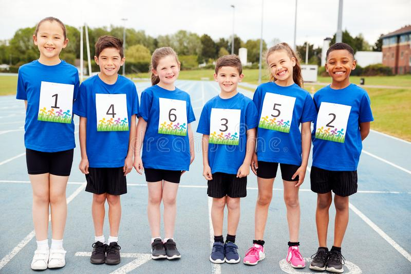Portrait Of Children On Athletics Track Wearing Competitor Numbers On Sports Day royalty free stock photos