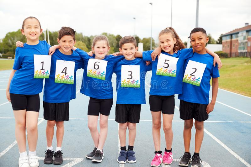 Portrait Of Children On Athletics Track Wearing Competitor Numbers On Sports Day stock photo