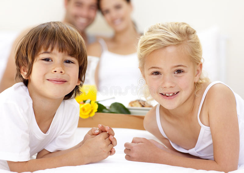 Download Portrait Of Children In Bed With Their Parents Stock Photo - Image: 11541354