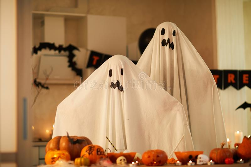 Children in ghost costumes at party stock photos