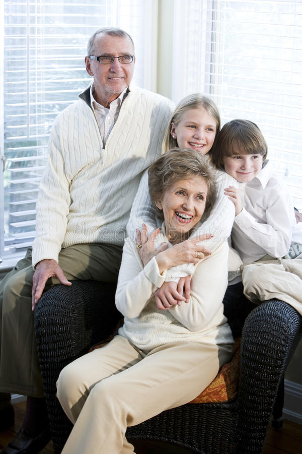 Portrait of children with grandparents. Together at home stock image