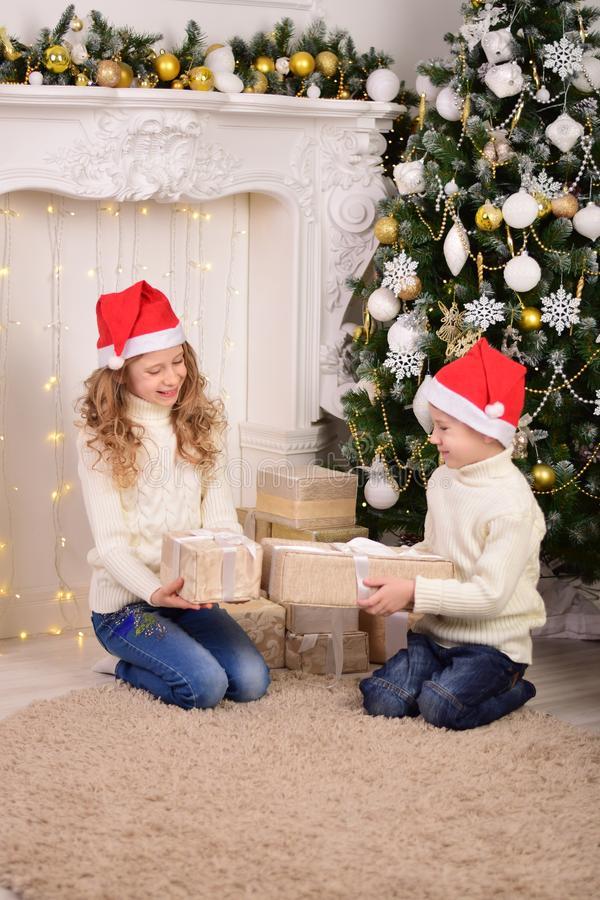 Portrait of children with New Year gifts Christmas royalty free stock photos