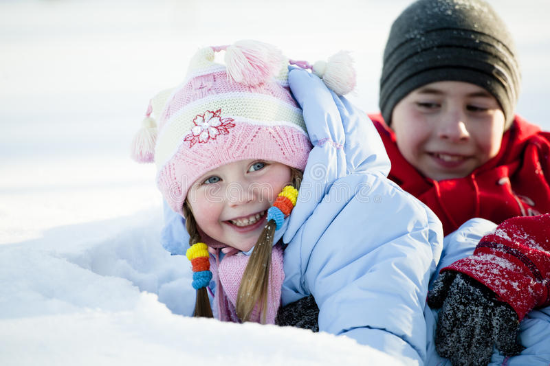 Download Portrait Of Children Playing In The Snow Stock Photo - Image of happy, beautiful: 24083982