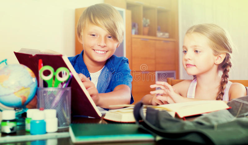 Portrait of children with textbooks. Portrait of smiling children with textbooks and notes royalty free stock image