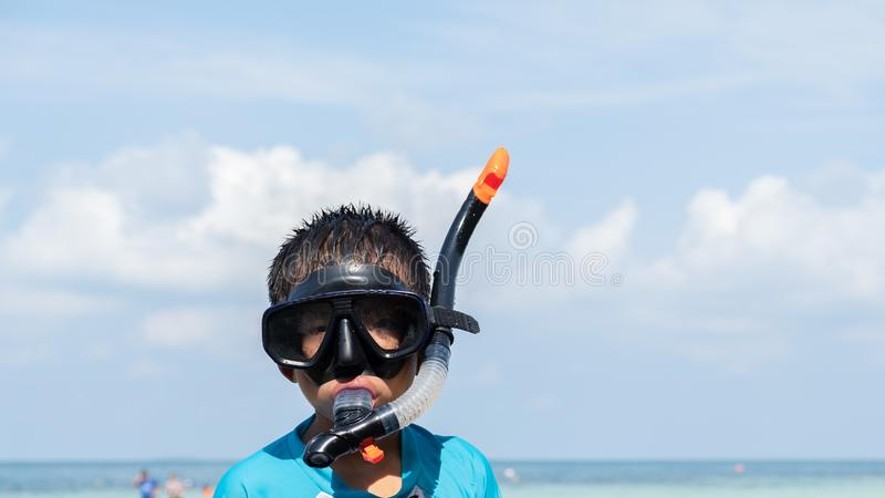 Portrait children wearing snorkeling on the beach stock photo