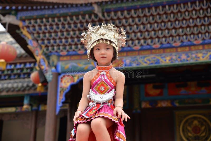 Chinese Miao nationality little girl. Portrait of a Chinese Miao nationality little girl wearing silver ornaments at Miao nationality , Guizhou province of China stock photo