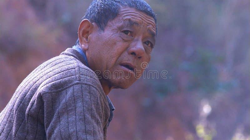 Portrait of chinese old man. Yunnan. China. royalty free stock image