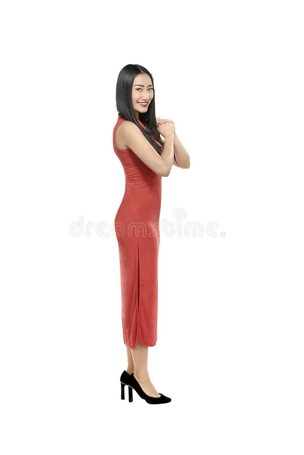 Portrait of chinese woman in cheongsam dress with gesture of con royalty free stock photography