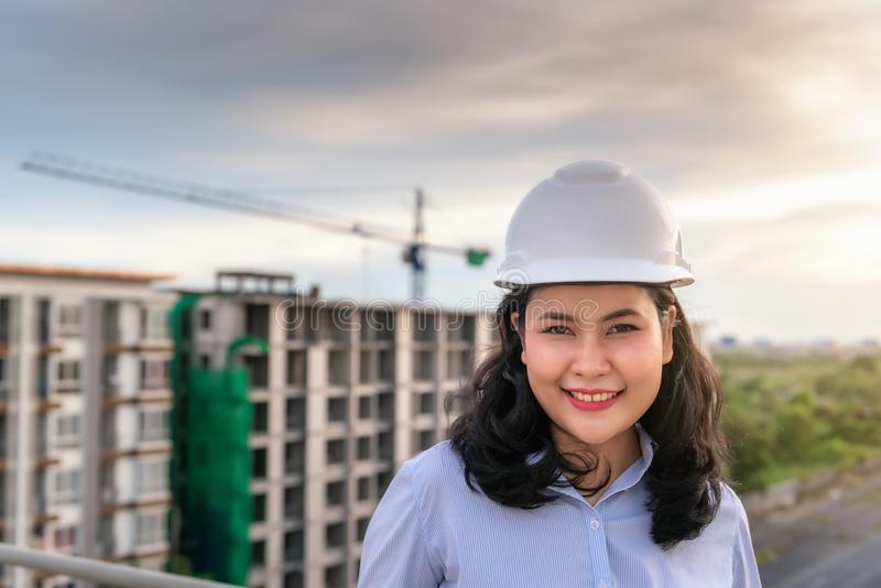 Portrait of Civil Engineer Woman in Construction Field, Attractive Smiling Worker in Safety Protective Hardhat Equipment at stock image