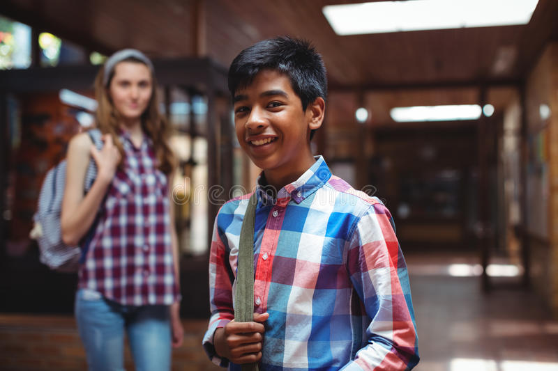 Portrait of classmate standing in corridor. At school royalty free stock photos