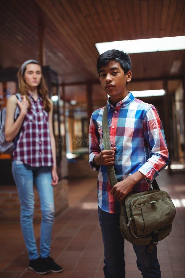 Portrait of classmate standing in corridor. At school stock photography