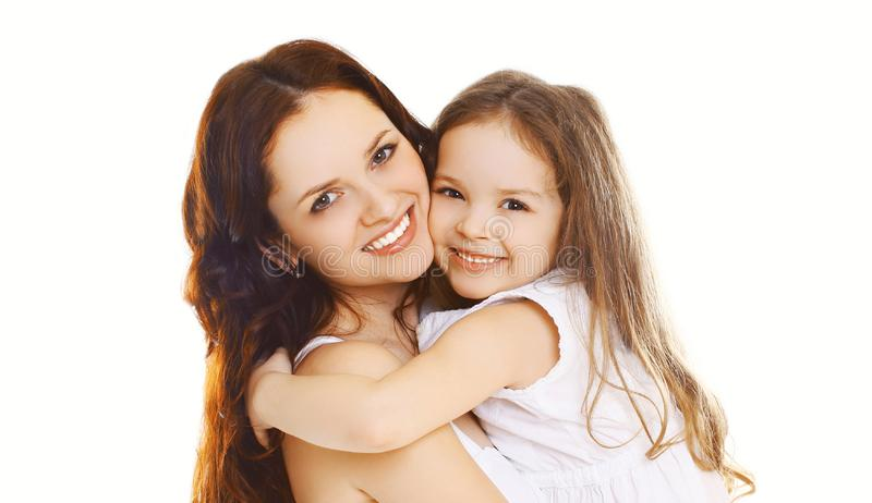Portrait close-up happy smiling mother with her little child daughter isolated on white stock images