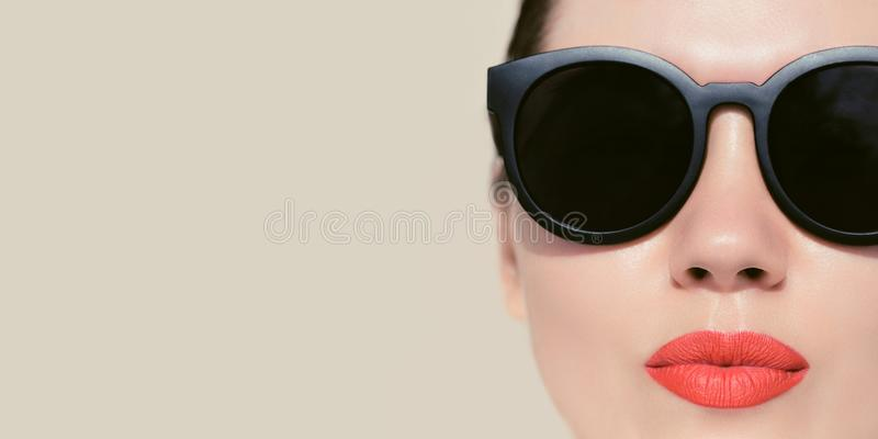 Portrait close up of a pretty woman with  sunglasses royalty free stock image