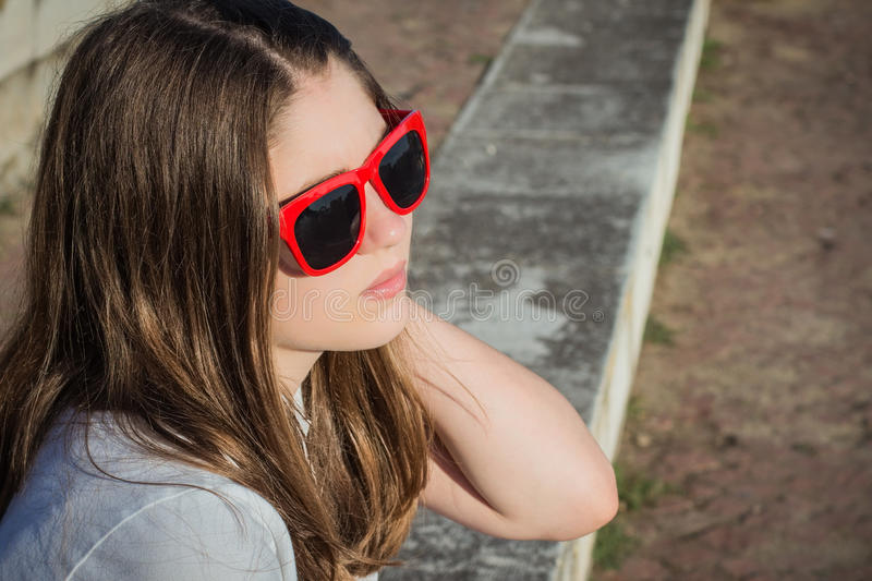 Portrait close up in profile of a pretty teenage girl stock photography