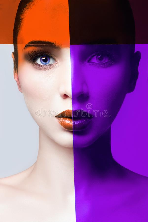 Portrait of a close-up woman with a red and purple film on her f. Ace, perfect lips and clean beautiful skin. Face care, perfect makeup royalty free stock images