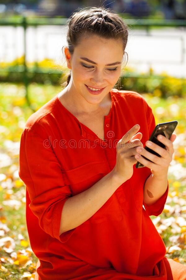 Portrait close up of young beautiful brunette woman in red shirt royalty free stock photography