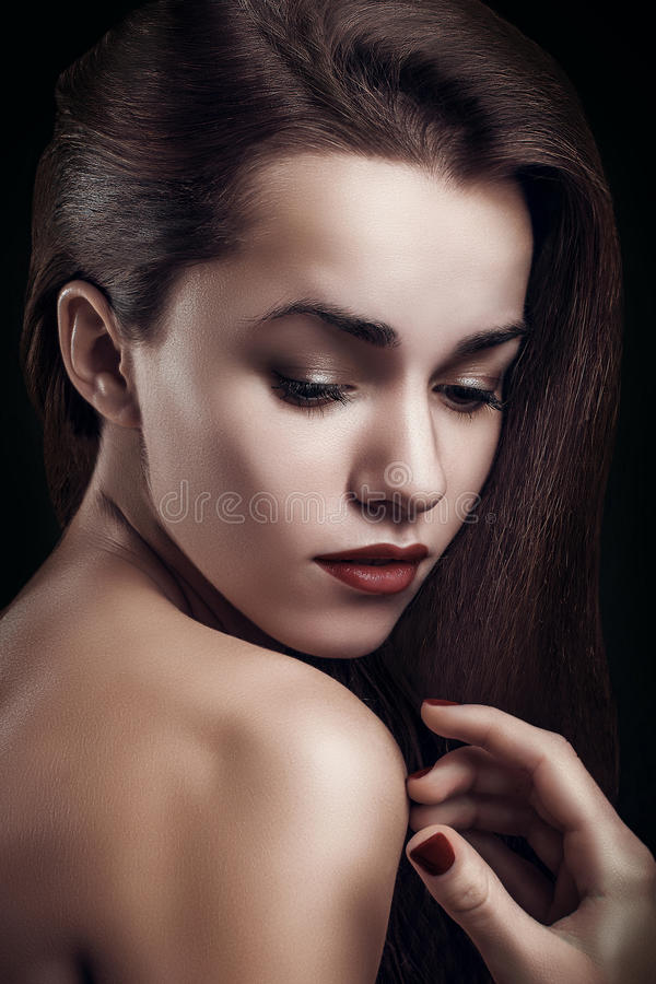 Portrait close up of young beautiful perfect woman high fashion model on dark background stock photography