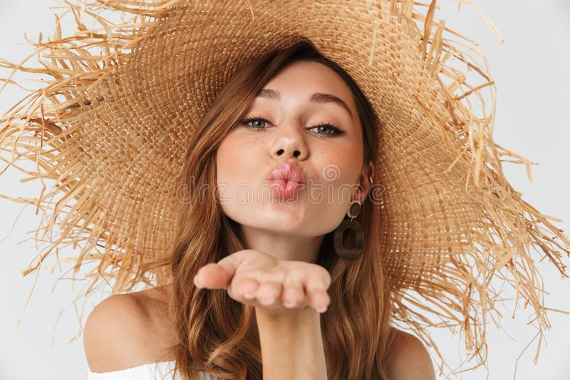 Portrait closeup of flirty adorable woman 20s wearing big straw royalty free stock image