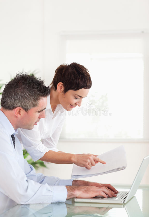 Download Portrait Of Colleagues Comparing A Blueprint Stock Image - Image of success, adult: 20876839