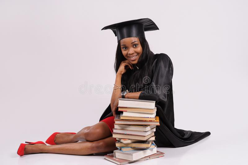 Portrait of student in graduation gown stock image