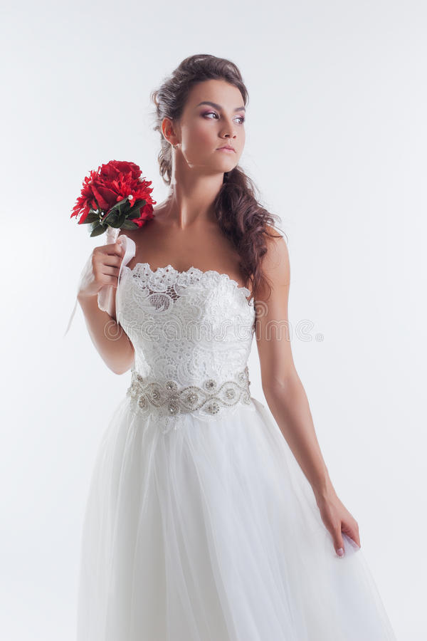 Portrait of concentrated bride posing in studio. Close-up royalty free stock photography