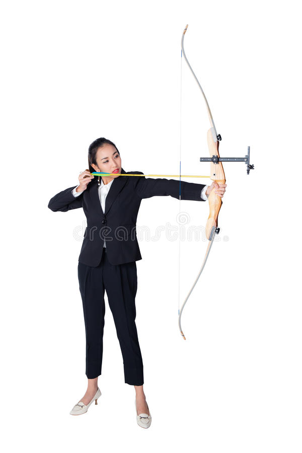 Portrait of concentrated female with crossbow in hands royalty free stock images