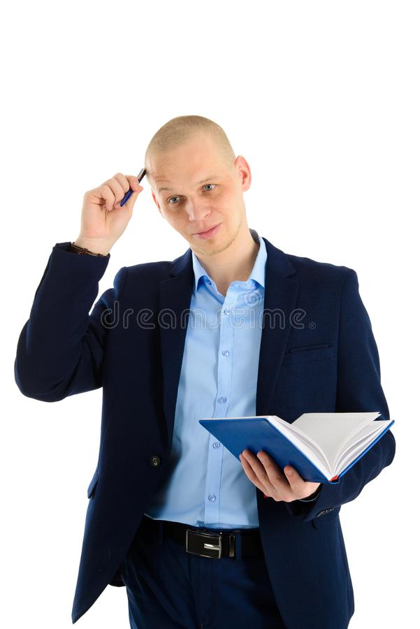 Portrait of a concentrated man in suit holding notebook and thinking, isoalted on white background. stock photos