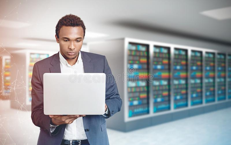 African American man, laptop server room polygons royalty free stock photography