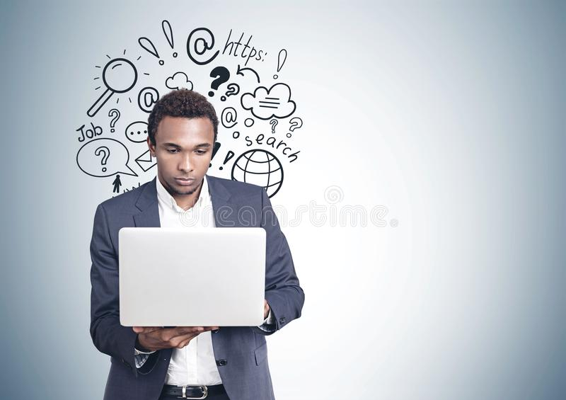African American man laptop internet search royalty free stock images