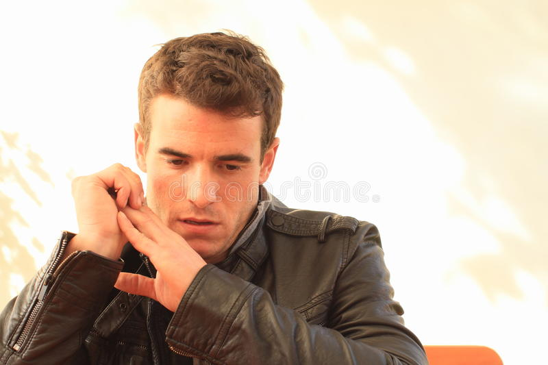 Portrait of concentrating man. Portrait of concentrating young man in black leather jacket stock photography