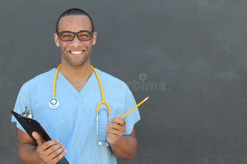 Portrait confident African American male doctor medical professional writing patient notes isolated on hospital clinic. Positive. Face expression stock photography