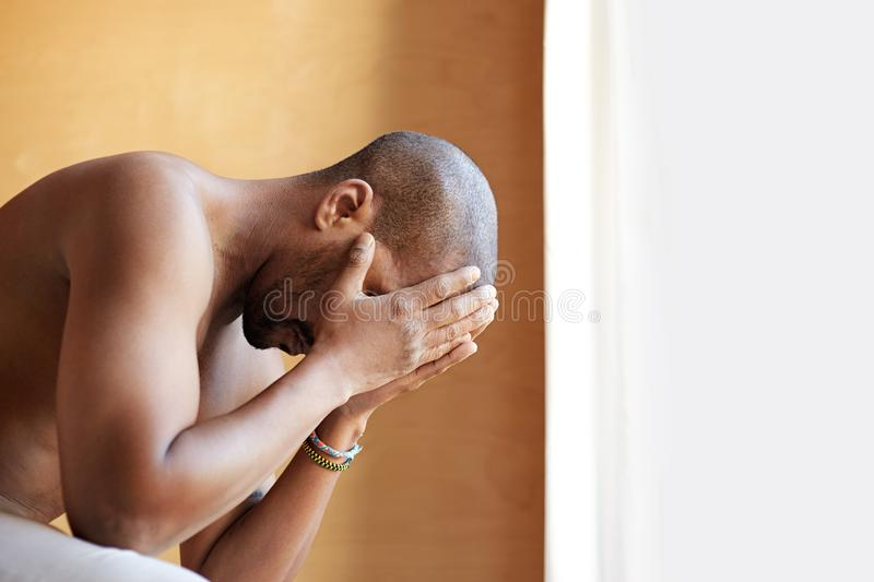 Portrait of confident african black man sitting in bedroom royalty free stock photo