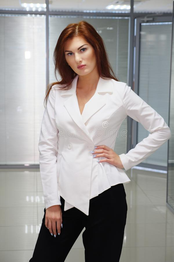 Portrait of confident beautiful redhaired businesswomanin in office royalty free stock image