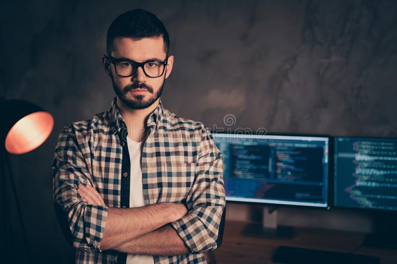 Portrait of confident brunet bearded guy ceo boss chief company founder professional expert specialist behind screen. Portrait of confident brunet bearded guy royalty free stock photography