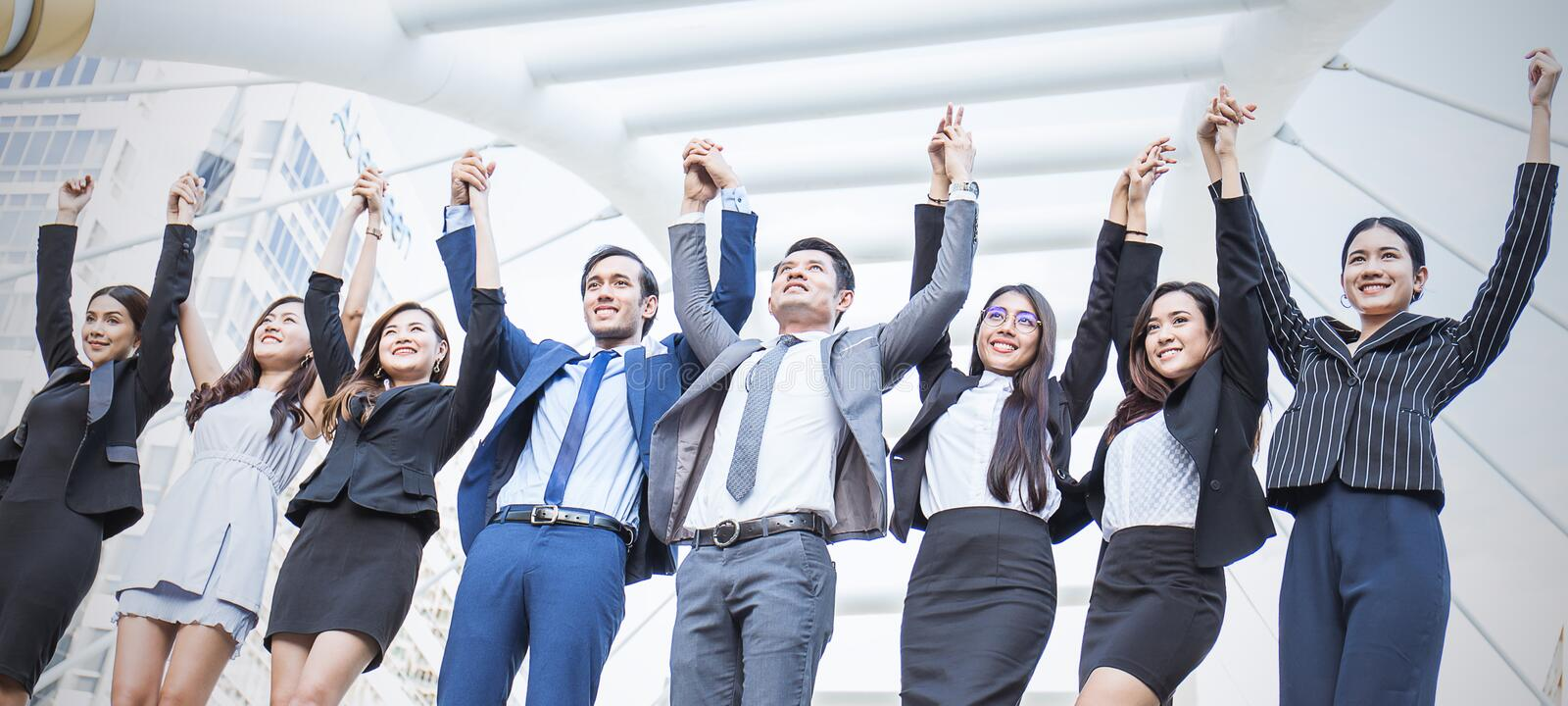 Portrait of confident business people group standing in row stock photo