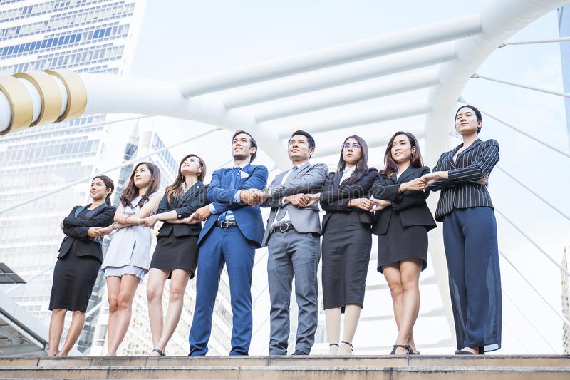Portrait of confident business people group standing in row royalty free stock image